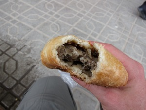 Street samsa. Cheap, generous with meat, delicious, and rumored to have cat and/or dog in it.