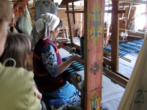 Weaving silk using traditional methods in Margilon.