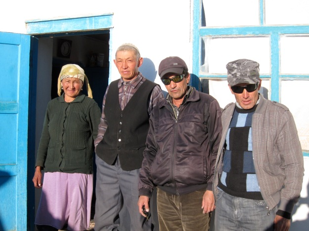 Our host family on the left  (Kyrgyz) and our drivers to the Murghab (Tajik)