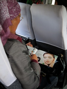 On the ride to Arslanbab: Don't let the headscarf fool you. Muslim women want to be beautiful, just the same.