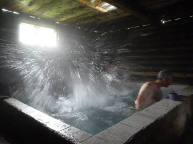 Avoiding hot mineral water getting in my eyes as Sjoerd proudly documents his cannonball.